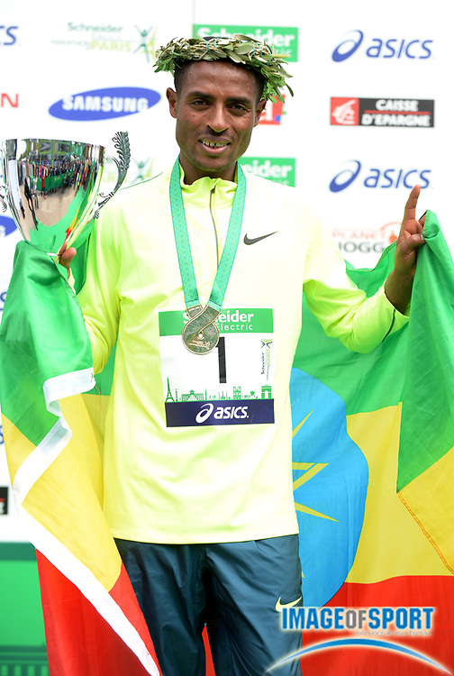 Apr 6, 2014; Paris, France; Kenenisa Bekele (ETH) poses with medal after winning the Schneider Electric Marathon de Paris in a course record 2:05.03 in his marathon debut. Photo by Jiro Mochizuki