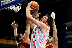 Giorgi Shermadini of Georgia between  Predrag Samardziski of Macedonia and Pero Antic of Macedonia during basketball game between National basketball teams of  Georgia and Former Yugoslav Republic of Macedonia at FIBA Europe Eurobasket Lithuania 2011, on September 8, 2011, in Siemens Arena,  Vilnius, Lithuania. (Photo by Vid Ponikvar / Sportida)