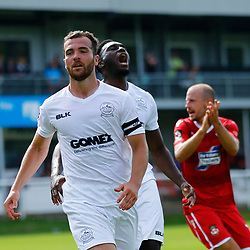 Dovers midfielder Mitch Brundle and Dovers forward Inih Effiong cant believe the penalty was saved during the opening National League match between Dover Athletic and Wrexham FC at Crabble Stadium, Kent on 04 August 2018. Photo by Matt Bristow.