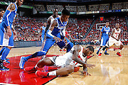 LOUISVILLE, KY - DECEMBER 29: Chane Behanan #21 of the Louisville Cardinals battles for the ball against Nerlens Noel #3 and Willie Cauley-Stein #15 of the Kentucky Wildcats at the KFC Yum! Center in Louisville, Kentucky. Louisville won 80-77. (Photo by Joe Robbins)