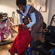 "Atlanta, Georgia/Central Africa Republic Refugee/Nestorine Lakas, 27, puts on her son Eric's coat as she prepares to take him to an appointment at the hospital with her daughter Carol, 3.  Eric,7, has cerebral palsy. Nestorine arrived in the U.S. in 2010 with her two young children from the Central African Republic. Eric requires a wheelchair and specialized healthcare. At the IRC in Atlanta, Nestorine is part of the Temporary Assistance for Needy Families (TANF) program where she is learning English, job skills and basic computer literacy so she can support her family as a single mom and learn how to manage her son's health needs. Unfortunately the father of Nestorine's children was not able to come to the U.S. with her, so she cares for her children and dreams of reuniting with him someday. Nestorine believes what makes her successful is ?working hard and overcoming challenges?. ""There was a war in my country and I fled to Cameroon. I was pregnant with my older son and gave birth along the way. When I fled I was alone. When I got to the camp I found my husbands name on a sign at the camp and we were reunited. My daughter Carol was born in Cameroon."" Because of her son's disability Nestorine got a humanitarian visa with the help of UNHCR. ""I am very happy to be here because they helped me a lot with my child. If I had stayed in CAR there isn't the healthcare that I have here. I am very thankful. The reason my child is still alive because I came as a refugee. Maybe the child would not have had any hope to walk. I hope one day he might walk.""."