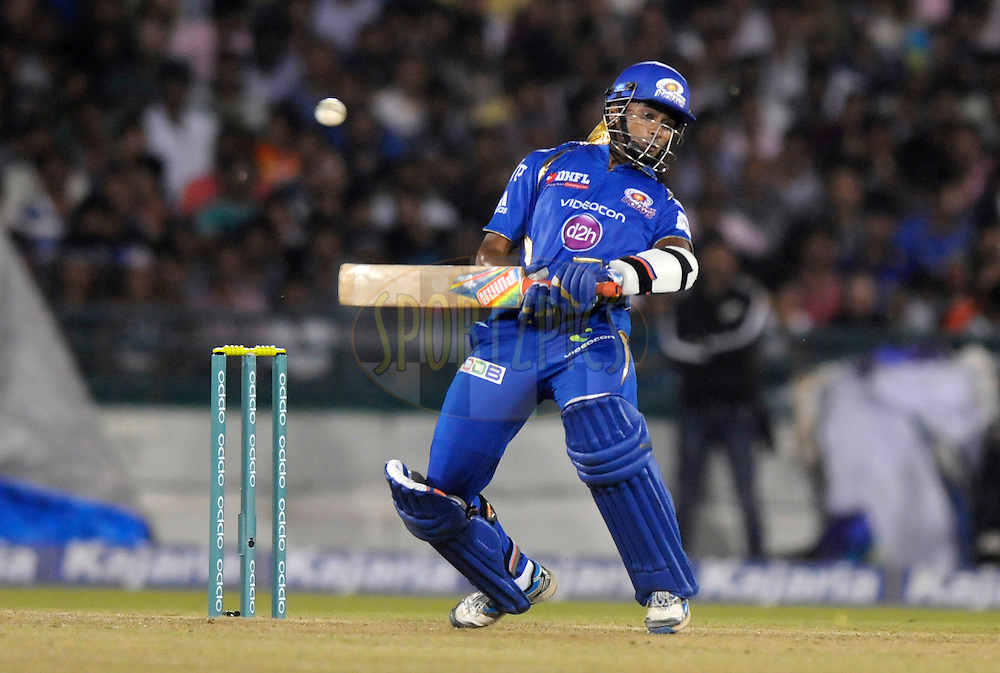 Aditya Tare of Mumbai Indians bats during the qualifier 2 match of the Oppo Champions League Twenty20 between the Mumbai Indians and the Lahore Lions held at the Chhattisgarh International Cricket Stadium, Raipur, India on the 13th September 2014<br /> <br /> Photo by:  Pal Pillai / Sportzpics/ CLT20<br /> <br /> <br /> Image use is subject to the terms and conditions as laid out by the BCCI/ CLT20.  The terms and conditions can be downloaded here:<br /> <br /> <br /> http://sportzpics.photoshelter.com/gallery/CLT20-Image-Terms-and-Conditions-2014/G0000IfNJn535VPU/C0000QhhKadWcjYs