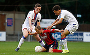 Connor Dymond and Spencer Forte keeping Josh Casey at bay during the Pre-Season Friendly match between Hampton & Richmond and Crystal Palace at Beveree Stadium, Richmond Upon Thames, United Kingdom on 27 July 2015. Photo by Michael Hulf.