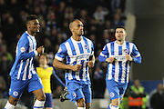 Chris O'Grady runs back to the centre circle after scoring  during the The FA Cup match between Brighton and Hove Albion and Arsenal at the American Express Community Stadium, Brighton and Hove, England on 25 January 2015.