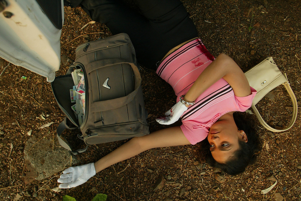 An actress lies on the ground during a shoot on a film location in Mumbai, India, December 7, 2004.
