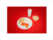A solitary olive, a fast-food binge... and a birthday cake: The bizarre last meals of death row killers before they face execution<br /> <br /> Even though they have been condemned to die for their crimes, the humanity of offering a death row prisoner a final meal fascinates like few other requests.<br /> Inspired by the forgiving gesture, Julia Ziegler-Haynes, a Brooklyn-based artist, has exhaustively trawled through the public records of death row inmates and selected 24 last meals, painstakingly recreated them and then photographed them.<br /> Produced for a book known as 'Today's Special', each one was cooked and prepared to the exact recorded likings and specifications of each prisoner, from a fast food blow-out to a single un-pitted black olive.<br /> 'Essentially, these prisoners had become guests in my home. And so, despite having been immersed in the hideous details of each crime, I repeatedly found myself feeling empathetic towards them. Especially those whose requests were so meager,' states Ziegler-Haynes.<br /> <br /> For example, one photograph depicts a black un-pitted olive, another, a single cup of coffee.<br /> Having been planning her photographic project for the past decade, the sculptor and printmaker shot her meals from the vantage point of the diner.<br /> This placed the viewer in the place of the condemned man and to help them think about what could possibly have been going through their mind as they ate their meal.<br /> Her visual aesthetic is inspired by Christian Boltanski's Compositions décoratives (1976), and significantly influenced by the food styling from that era with its faded backdrops and unappetizing simplicity – likened to food images from the windows of cheap restaurants. <br /> Envisioning how each meal would appear served in the prisons, Ziegler-Haynes then juxtaposed her versions against vibrant backgrounds to liven what she assumed to be the opposite of their actual presentation.<br /> 'I imagine, for instance, they serve
