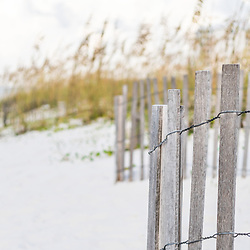 Pensacola Beach Florida beach fence and beach grass panorama photo. Pensacola Beach is a coastal city in the Emerald Coast area of the Southeastern United States. Panoramic photo ratio is 1:3. Copyright ⓒ 2018 Paul Velgos with All Rights Reserved.