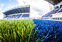 A landscape image taken with a fish-eye lens showing the new plasctic pitch work at The Falkirk Stadium, with the new pitch work for the Scottish Championship game v Morton. The woven GreenFields MX synthetic turf and the surface has been specifically designed for football with 50mm tufts compared with the longer 65mm which has been used for mixed football and rugby uses.  It is fully FFA two star compliant and conforms to rules laid out by the SPL and SFL.<br /> &copy;Michael Schofield.