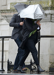 © Licensed to London News Pictures. 14/05/2012. City of London, UK People battle with the rain and wind. The Dalai Lama arrives at St Paul's Cathedral today 14 may 2012 to be presented with the £1.1m Templeton annual prize in his first visit to the Cathedral. The award is for a living person who has 'made an exceptional contribution to affirming the spiritual dimension of life'.. Photo credit : Stephen Simpson/LNP