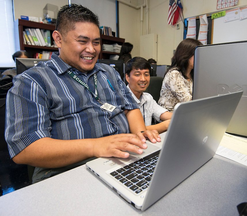 Roderick Bodeta test drives his new laptop during the PowerUp laptop distribution and training at Austin High School, August 13, 2013.