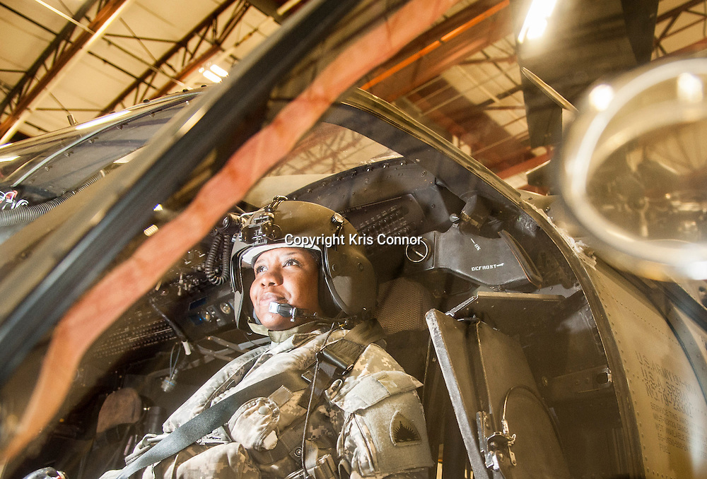 First Lieutenant Dina Elosiebo of Memphis, TN poses with a Washington DC National Guard UH-60 BlackHawk at Davison Army Airfield in Fort Belvoir, Va on April 15th, 2014. Elosiebo is the first female black helicopter pilot in the Washington DC National Guard. Photo by Kris Connor