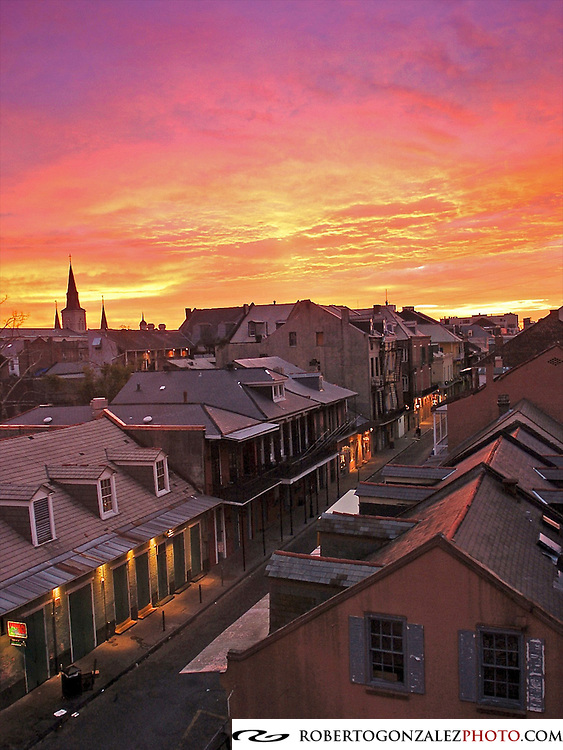 Mardi Gras colors fill the sky at sunrise over Bourbon St. and Toulouse Ave. in the French Quarter. There is hope that tourism might help rebuild after Hurricane Katrina devasted the city, New Orleans, Friday, February, 10, 2006. (Roberto Gonzalez/Orlando Sentinel) project number 1027064