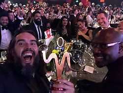 """Russell Brand releases a photo on Twitter with the following caption: """"""""What a night at the #curryoscars and CONGRATULATIONS MALIKS💫you'll note that @thedavidseaman is at our table, them hands are as safe as ever.  @MaliksGroup @BritCurryAwards"""""""". Photo Credit: Twitter *** No USA Distribution *** For Editorial Use Only *** Not to be Published in Books or Photo Books ***  Please note: Fees charged by the agency are for the agency's services only, and do not, nor are they intended to, convey to the user any ownership of Copyright or License in the material. The agency does not claim any ownership including but not limited to Copyright or License in the attached material. By publishing this material you expressly agree to indemnify and to hold the agency and its directors, shareholders and employees harmless from any loss, claims, damages, demands, expenses (including legal fees), or any causes of action or allegation against the agency arising out of or connected in any way with publication of the material."""