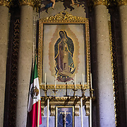 MEXICO CITY, MEXICO --A painting of Our Lady of Guadalupe in a chapel in the Metropolitan Cathedral. Built in stages from 1573 to 1813, the Mexico City Metropolitan Cathedral is the largest Roman Catholic cathedral in the Americas. It sits in the heart of the historic quarter of Mexico City along one side of the the Zocalo.