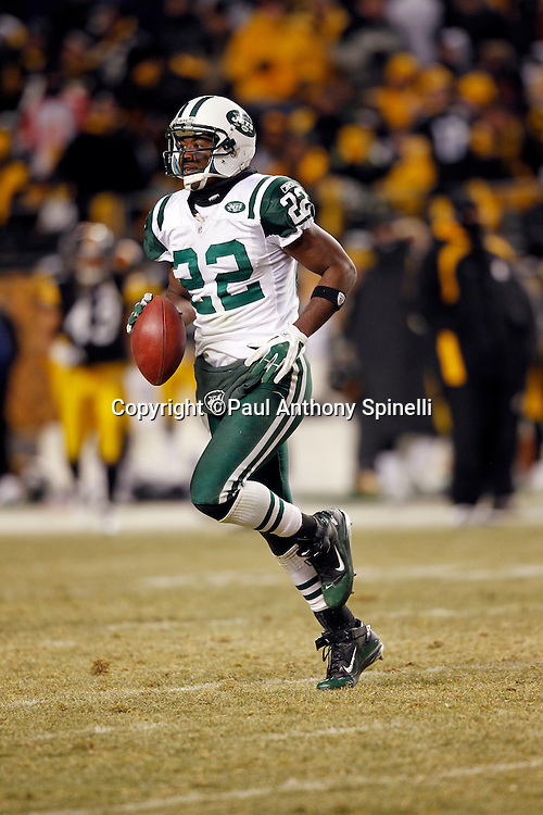 New York Jets safety Brodney Pool (22) runs back to the bench with a ball trophy after intercepting a third quarter pass near the Jets end zone during the NFL 2011 AFC Championship playoff football game against the Pittsburgh Steelers on Sunday, January 23, 2011 in Pittsburgh, Pennsylvania. The Steelers won the game 24-19. (©Paul Anthony Spinelli)