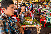 30 APRIL 2013 - MAHACHAI, SAMUT SAKHON, THAILAND:  Unemployed Burmese men who were lured to Thailand with the promise of jobs relax in a Burmese tea shop in Mahachai, Samut Sakhon province, Thailand. The Thai fishing industry is heavily reliant on Burmese and Cambodian migrants. Burmese migrants crew many of the fishing boats that sail out of Samut Sakhon and staff many of the fish processing plants in Samut Sakhon, about 45 miles south of Bangkok. Migrants pay as much $700 (US) each to be smuggled from the Burmese border to Samut Sakhon for jobs that pay less than $5.00 (US) per day. There have also been reports that some Burmese workers are abused and held in slavery like conditions in the Thai fishing industry.          PHOTO BY JACK KURTZ
