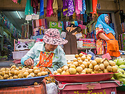 02 NOVEMBER 2012 - HAT YAI, SONGKHLA, THAILAND: A Buddhist woman and a Muslim woman sell fruit in the market in Hat Yai, Songkhla, Thailand. Hat Yai is the commercial center of south Thailand and a popular weekend vacation destination for Malaysian and Singaporean tourists.    PHOTO BY JACK KURTZ
