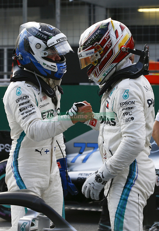 April 28, 2018 - Baku, Azerbaijan - Mercedes AMG Petronas teammates VALTTERI BOTAS, left, of Finland, and LEWIS HAMILTON of Great Britain, celebrate finishing 3rd and 2nd respectively after qualifying for the Formula One Azerbaijan Grand Prix. (Credit Image: © Hoch Zwei via ZUMA Wire)