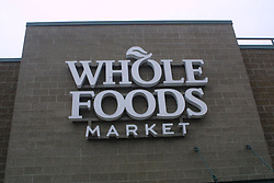 Jun 16, 2017 - Eugene, Oregon, U.S. - Exterior views of Whole Foods logo and sign. Amazon has acquired Whole Foods, a move that marks the e-commerce giant's official entry into the world of physical stores as well as groceries. It's Amazon's biggest acquisition ever, paying $13.7 billion in cash for the grocery chain, which now operates some 465 stores across the U.S. Amazon has grown into a retail behemoth and has has been tip-toeing into bookstores and experimental convenience stores. Those efforts led to speculation that Amazon eventually would make a major acquisition of a chain, rather than slowly build out its own stores. That acquisition ended up being Whole Foods. (Credit Image: © Shalan Stewart/ZUMA Wire/ZUMAPRESS.com)