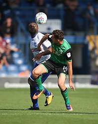 Nathan Cameron of Bury (L) and Tom Hopper of Scunthorpe United in action - Mandatory by-line: Jack Phillips/JMP - 02/09/2017 - FOOTBALL - Gigg Lane - Bury, England - Bury v Scunthorpe United - English Football League One