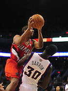 Dec. 10 2010; Phoenix, AZ, USA; Portland Trailblazers guard Andre Miller (24) puts up a basket during the first half against Phoenix Suns center Earl Barron (30) at the US Airways Center. Mandatory Credit: Jennifer Stewart-US PRESSWIRE.