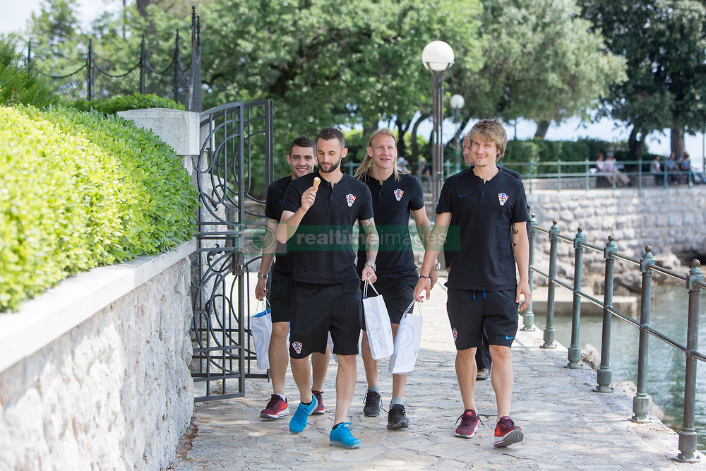OPATIJA, June 5, 2018  Players of Croatian national football team Mateo Kovacic (L1), Marcelo Brozovic (L2), Domagoj Vida (L3) and Tin Jedvaj (R) walk on the street of Opatija, Croatia, on June 4, 2018. The team is preparing for 2018 FIFA World Cup as head coach Zlatko Dalic announced on Monday his final list of 23 players who will represent Croatia in Russia. (Credit Image: © Nel Pavletic/Xinhua/Xinhua via ZUMA Wire)