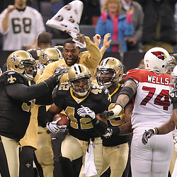 16 January 2010:  New Orleans Saints safety Darren Sharper (42) celebrates following a Arizona Cardinals turnover during a 45-14 win by the New Orleans Saints over the Arizona Cardinals in a 2010 NFC Divisional Playoff game at the Louisiana Superdome in New Orleans, Louisiana.