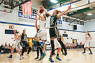 Rice forward Lizzy Lyman (22) blocks the shot by Mount Mansfield forward Katie Estes (14) during the girls basketball game between the Rice Green knights and the Mount Mansfield Cougars at MMU High School on Friday night December 4, 2015 in Jericho. (BRIAN JENKINS/for the FREE PRESS)