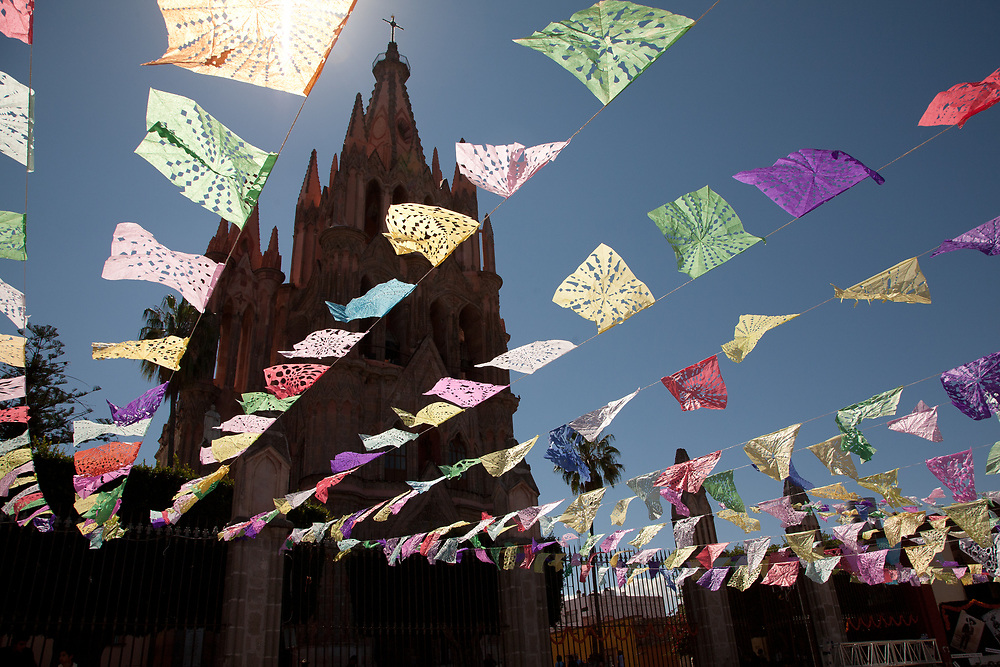"North America, Mexico, San Miguel de Allende, La Parroquia de San Miguel Church and streamers of tissue paper flags, known as ""Papel Picado"""