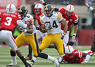 November 25, 2011: Iowa Hawkeyes running back Marcus Coker (34) on a run during the first half of the NCAA football game between the Iowa Hawkeyes and the Nebraska Cornhuskers at Memorial Stadium in Lincoln, Nebraska on Friday, November 25, 2011. Nebraska defeated Iowa 20-7.