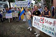 Frankfurt am Main | 05 July 2014<br /> <br /> Am Samstag (05.07.2014) demonstrierten am Domplatz in Frankfurt am Main etwa 25 Menschen f&uuml;r die Unabh&auml;ngigkeit der Ukraine und gegen den Einfluss von Russland.<br /> Hier: Demonstranten mit einem Plakat mit der Aufschrift &quot;Putin Stop - Heute Ukraine - Morgen Europa&quot; und einem Hakenkreuz.<br /> <br /> [Foto honorarpflichtig, kein Model Release]<br /> <br /> &copy;peter-juelich.com
