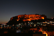 The fort is lit by flood lights as dusk sets in in Jodhpur, the blue city of Rajasthan, India..Photo by Suzanne Lee