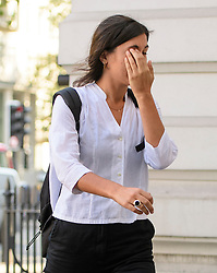© London News Pictures. 14/09/2016. London, UK. NATALIE FIENNES, cousin of actors Ralph Fiennes, covers her face as she arrives at Westminster Magistrates Court in London where she is one of nice Black Lives Matter campaigners who face charges relating to a protest at London City Airport on September 6, in which the protest group locked themselves together on the airport's runway.  Photo credit: Ben Cawthra/LNP