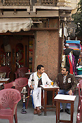 Men in  outdoor cafe with hookah, Cairo, Egypt
