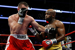 Feb 27, 2009; Newark, NJ, USA; Tomasz Adamek (red/white) and Johnathon Banks (gold) trade punches during their 12 round IBF Cruiserweight championship fight at the Prudential Center.  Adamek won via 8th round KO.