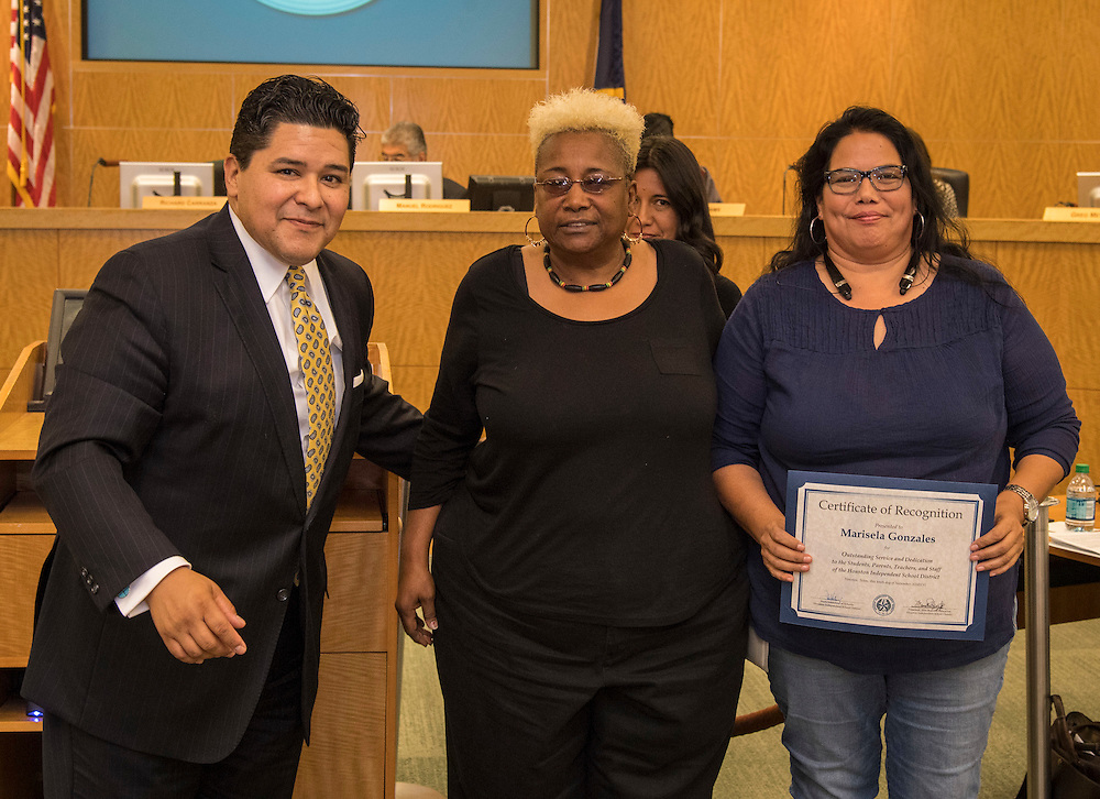 Superintendent Richard Carranza, left, and Wretha Thomas, center, recognize Marisela Gonzales, right, during the Houston ISD Board of Trustee meeting, November 10, 2016.