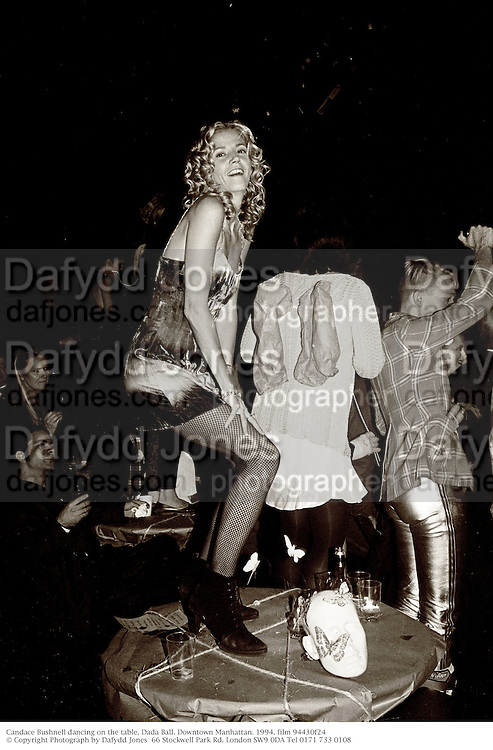 Candace Bushnell dancing on the table. Dada Ball. Downtown Manhattan. 1994. film 94430f24<br />&copy; Copyright Photograph by Dafydd Jones<br />66 Stockwell Park Rd. London SW9 0DA Tel 0171 733 0108
