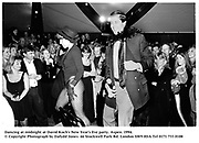 Dancing at midnight at David Koch's New Year's Eve party. Aspen. 1994.<br />