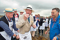 08/09/2013 Singing to the Oysters<br /> <br /> To help wake the Native Oysters from their beds &quot;The Brook Singers&quot;, a male voice choir from Dublin, accompanied by Peter Caviston of Caviston's Food Emporium, (seen here enjoying one of the first of the season straight from the bay  opened by Diarmuid Kelly rhs )in Glasthule called to Kelly Oysters in inner Galway Bay.<br /> September is a busy month for the Native Oysters which have just come back into season.<br /> The singers will help the oysters prepare for the upcoming Galway international Oyster Festival at the end of the Month . As well as supplying the Oyster Festivals, Kelly Oysters supply oysters throughout Ireland and around the world.<br /> Last season these much sought after delicacies were exported to 14 different countries.   Photo: Andrew Downes