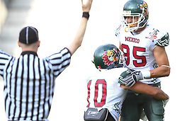 08.07.2011, Tivoli Stadion, Innsbruck, AUT, American Football WM 2011, Group A, Germany (GER) vs Mexico (MEX), im Bild Arzate Erick  (Mexico, #10, WR) and Ruíz  Oscar (Mexico, #85, WR) celebrating after a touchdown // during the American Football World Championship 2011 Group A game, Germany vs Mexico, at Tivoli Stadion, Innsbruck, 2011-07-08, EXPA Pictures © 2011, PhotoCredit: EXPA/ T. Haumer