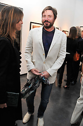 SIMON LE BON at a private view of photographs by Herb Ritts held at Hamiltons Gallery, 13 Carlos Place, London on 21st June 2011.