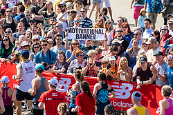 © Licensed to London News Pictures. 22/04/2018. London, UK. Spectators cheer marathon runners on as they pass the Cutty Sark in Greenwich during the Virgin Money London Marathon 2018. Photo credit: Rob Pinney/LNP