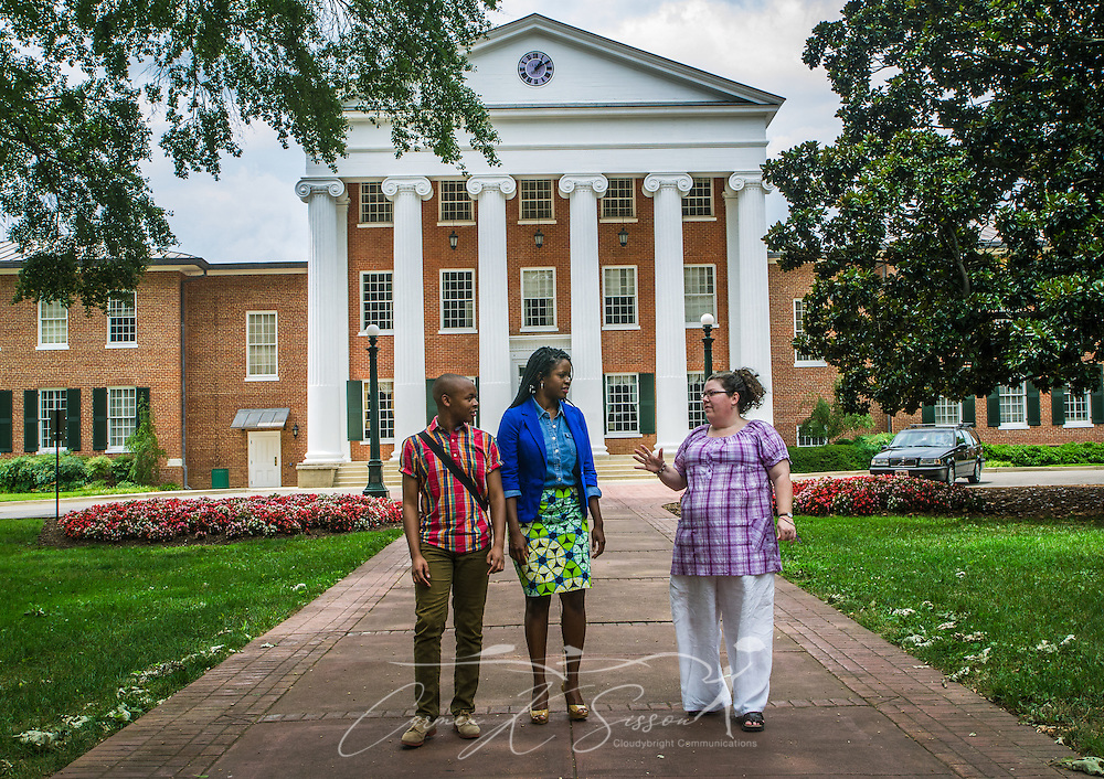 University of Mississippi students Nathaniel Weathersby and Renee Ombaba talk with Susan Glisson, executive director of the William Winter Institute for Racial Reconciliation, as they walk through The Grove on campus, July 30, 2013, in Oxford, Miss. Ombaba and Glisson organized a candlelight unity walk last fall after a racially-charged skirmish broke out in front of the Lyceum (pictured behind them) following the re-election of President Barack Obama. The Lyceum was also the site of violence in October 1962, when riots broke out after James Meredith enrolled as the first black student on campus. (Photo by Carmen K. Sisson)