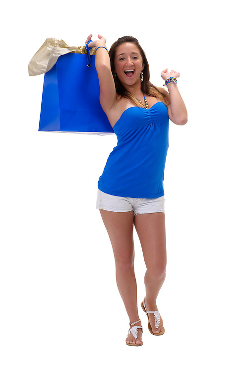 Young hispanic girl very happy with shopping bags.