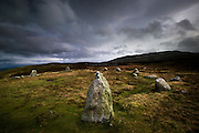 Meini Hirion, (meaning long stones) is known in English as Druid's Circle, is a prehistoric stone circle on the hilltop above Penmaenmawr, North Wales. The mountain of Tal-y-Fan can be seen in the background. However the circle has nothing to do with Druidism as excavations of 1958-59 confirmed that it belonged to the early part of the bronze age, about 1450-1400 B.C., and that's 1000 years before the druids came to this part of Britain with the Iron Age invaders.