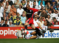 Photo: Rich Eaton.<br /> <br /> Derby County v Southampton. Coca Cola Championship.<br /> <br /> 06/08/2006. #17 Djamel Belmadi of Southampton is tackled by Derbys Richard Jackson