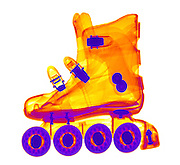 An X-ray of a Rollerblade Boot. The rollerblade boot is shown in x-ray imaging.  The wheels and bearings are at the bottom and the latches and rivets appear as dark, since they are made out of denser materials.  Rollerblading is a popular activity for exercise.