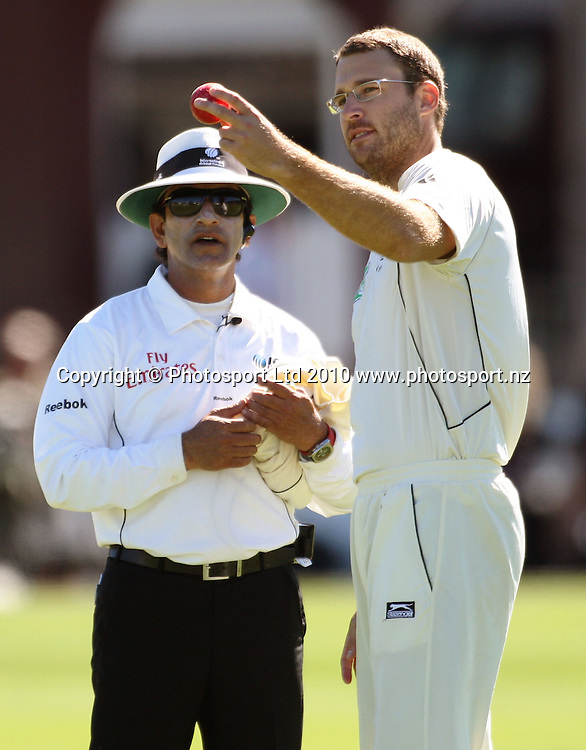 NZ captain Daniel Vettori shows the damaged ball to umpire Asad Rauf.<br /> 1st cricket test match - New Zealand Black Caps v Australia, day five at the Basin Reserve, Wellington. Tuesday, 23 March 2010. Photo: Dave Lintott/PHOTOSPORT