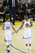 Golden State Warriors guard Stephen Curry (30) and Golden State Warriors guard Ian Clark (21) celebrate against the Portland Trail Blazers at Oracle Arena in Oakland, Calif., on October 21, 2016. (Stan Olszewski/Special to S.F. Examiner)