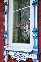 """Beautiful traditional wood scrolls decorate a window in Uglich, Russia. As one of Russia's """"Golden Ring"""" cities, Uglich is designated a town of significant cultural and historic importance."""
